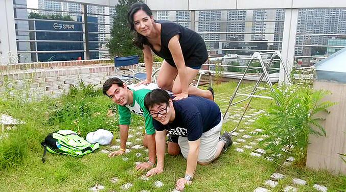 Human pyramid on a roof