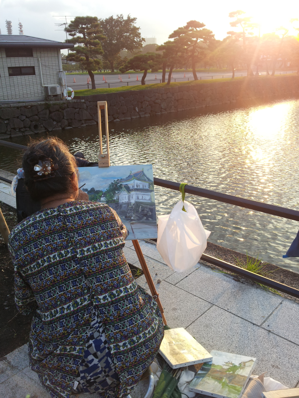 Lady painting the palace